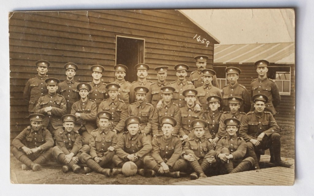 George Stonely with other members of the Cheshire Regiment - George is shown in the centre of the photograph with the ball