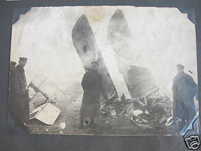 Gefreiter Wilhelm Hasenbein appears in front of Leonard Arthur Tilney's wreckage. Hasenbein is shown marked 'x'.