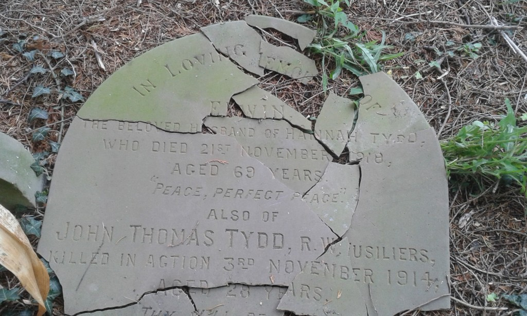 Fragments of the family headstone in St John the Divine Church, Burwardsley, on which is recorded the death of Private John Thomas Tydd
